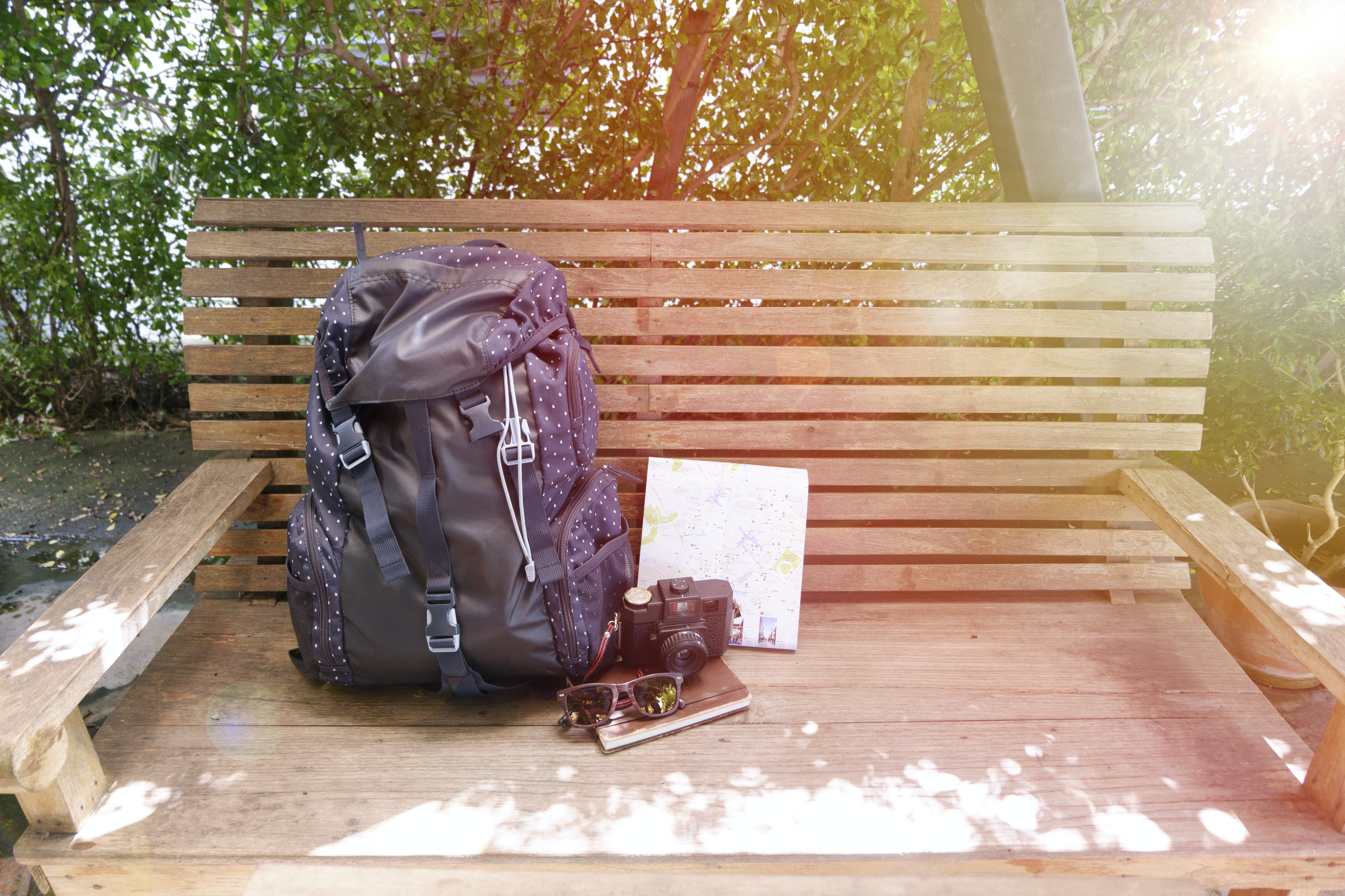 Blue Backpack on Brown Wooden Bench