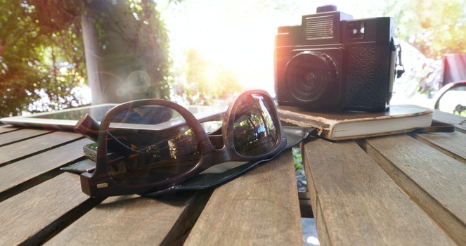Free stock photo of wood, sunglasses, camera, table