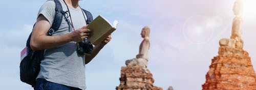 Man Holding Book Outdoor