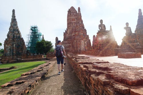 Man Walking Beside Ruins