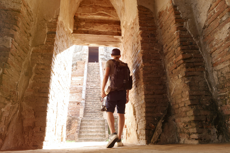 Man Walking Towards Arc