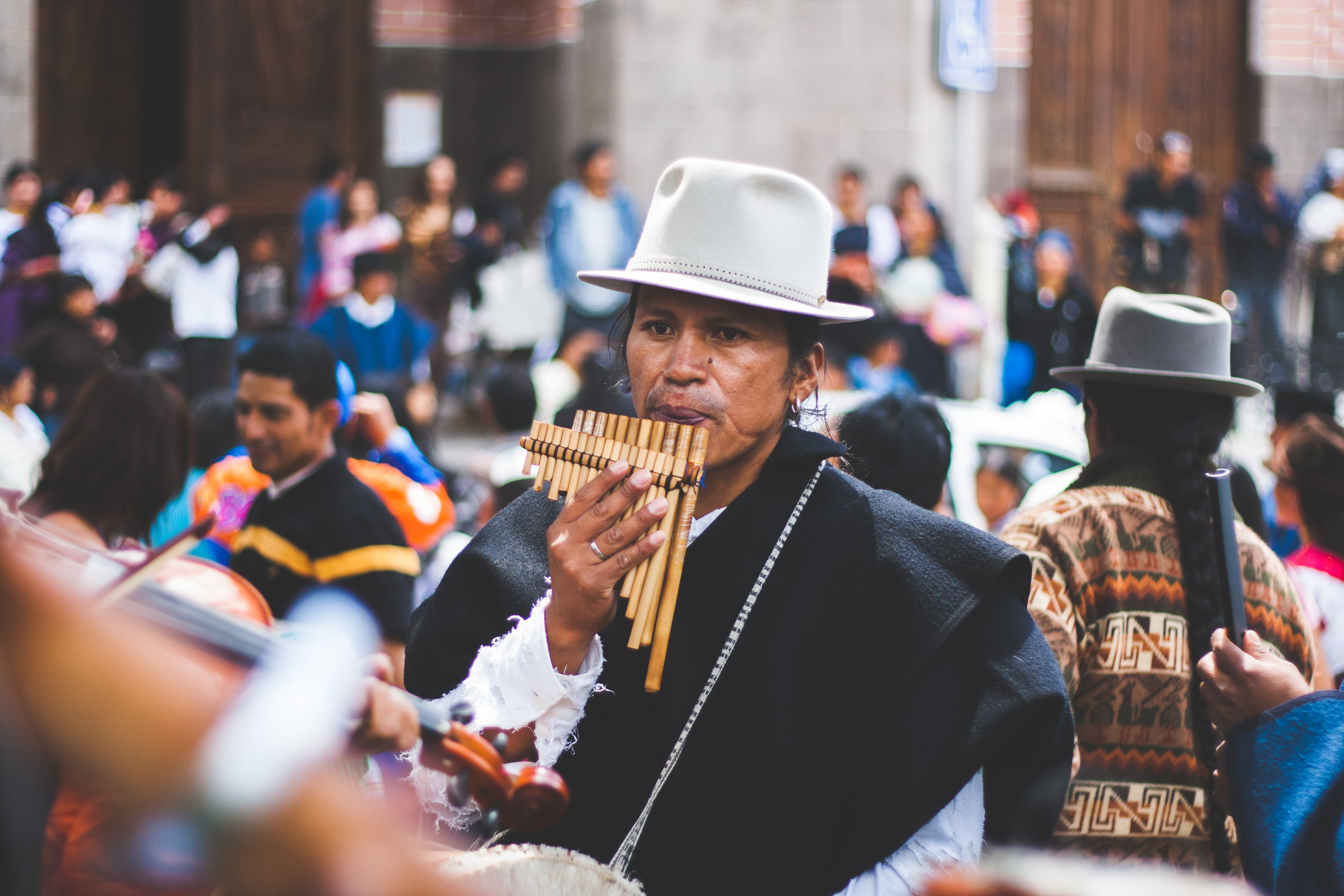 Man Playing Bamboo Wind Instrument