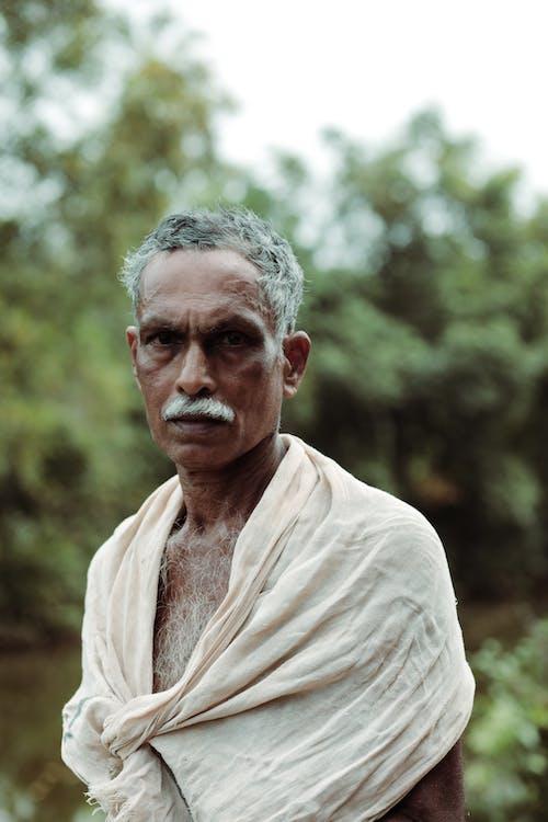 Macro Photography of Standing Man