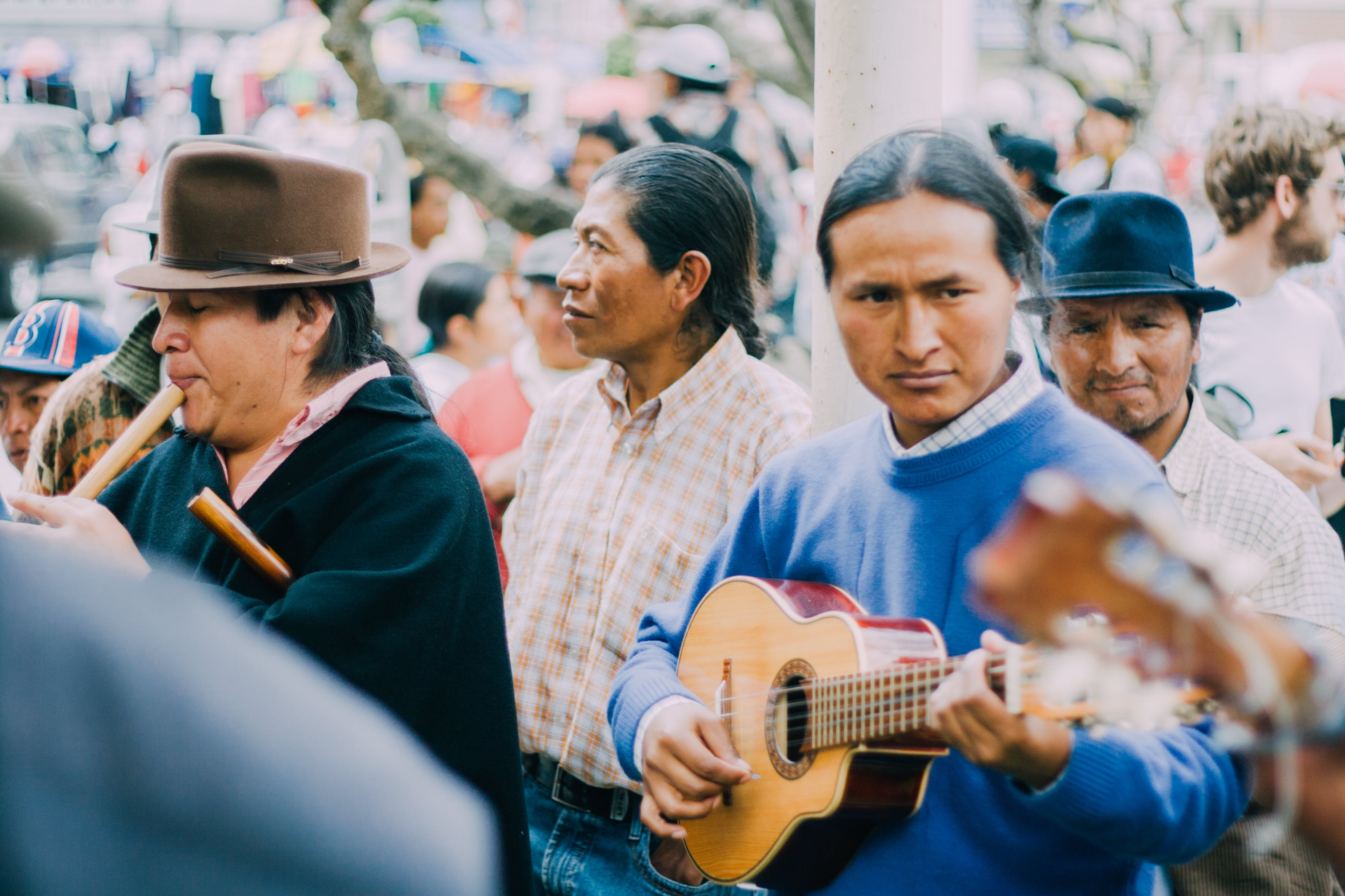 Man Playing Acoustic Guitar Beside People during Daytime