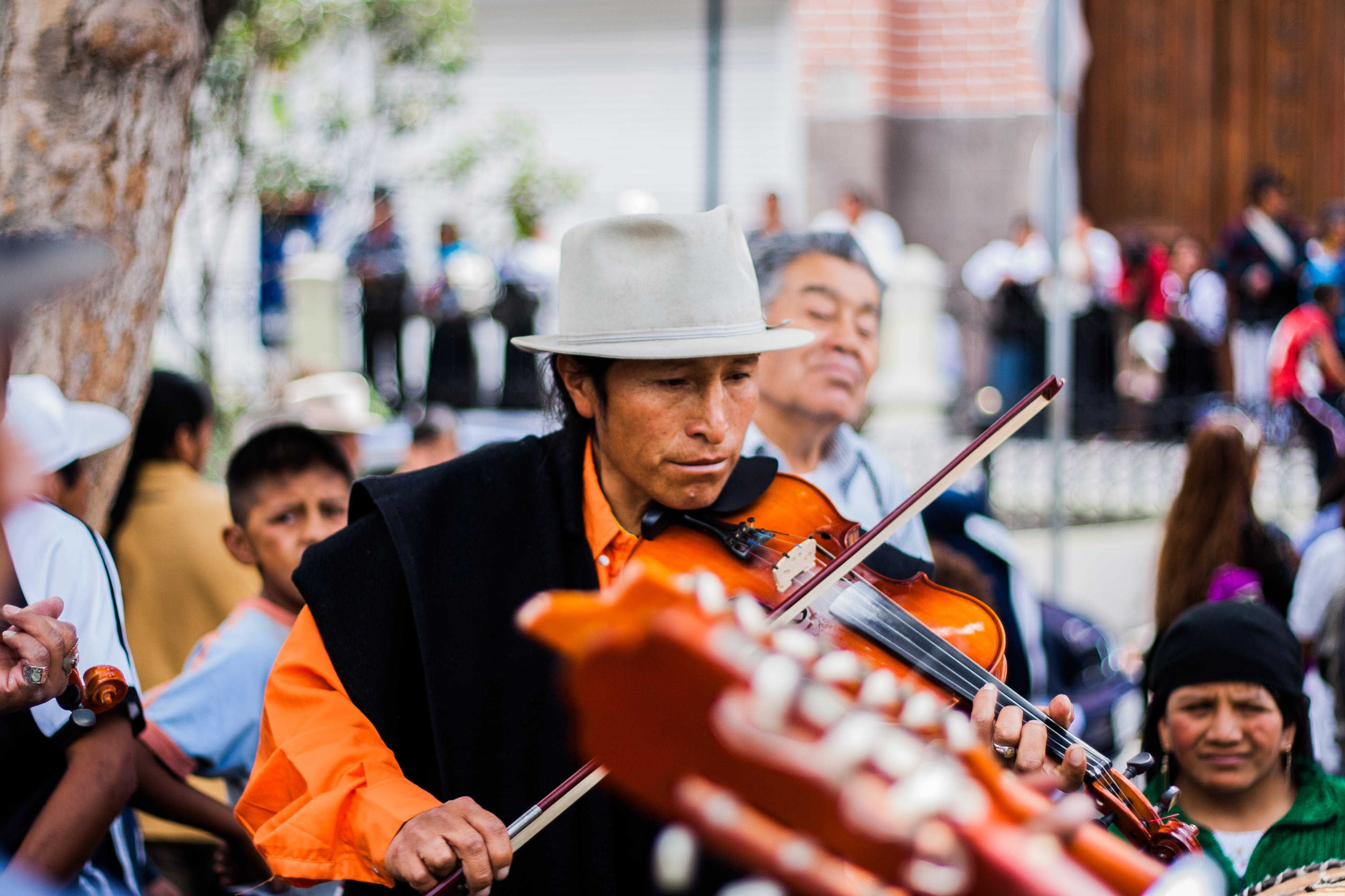 Man Playing the Violin on the Street