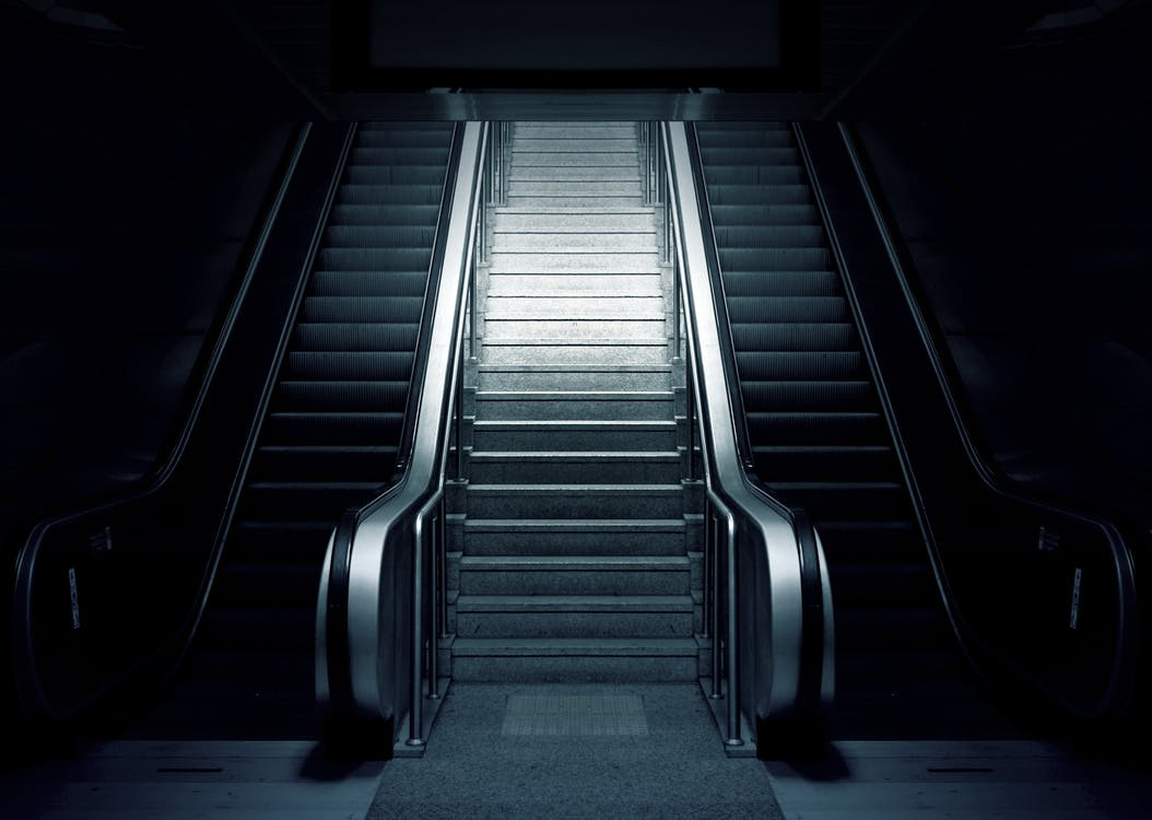 Grey and Black Escalator on Dimmed Place