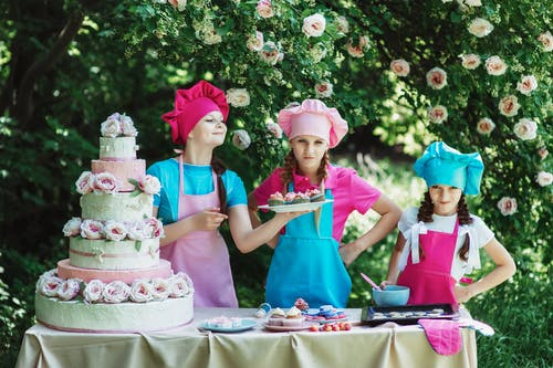 3 Person's Preparing the Cake and the Cup Cakes