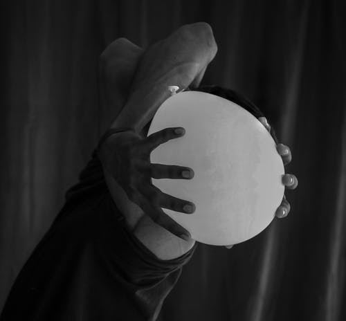 Gray-scale Photography of Person Holding Balloon