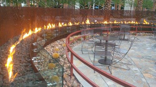 Foto profissional grátis de copo, cova, fogueira, parede de metal