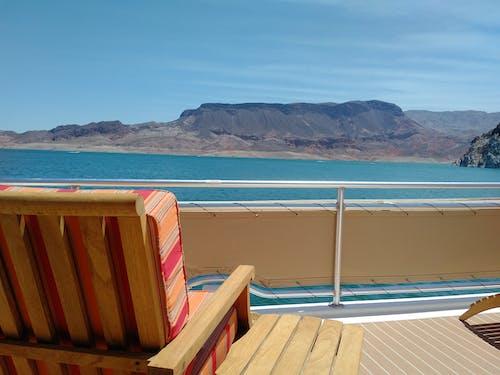 Foto profissional grátis de água, barco, cadeira, lago