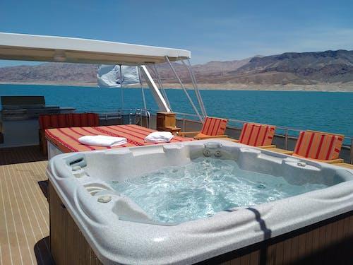 Foto profissional grátis de barco, jacuzzi, lago, spa
