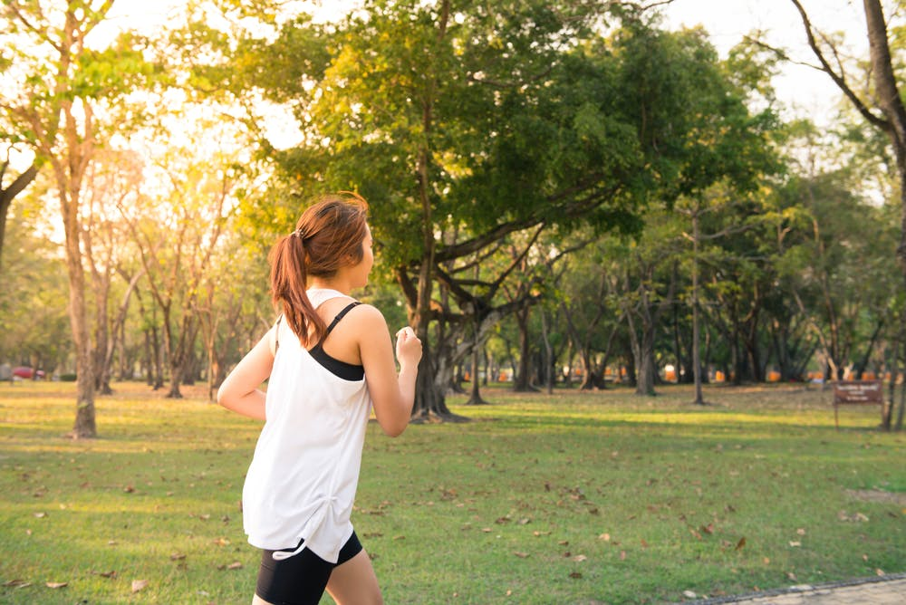 Woman about to run during golden hour.   Photo: Pexels