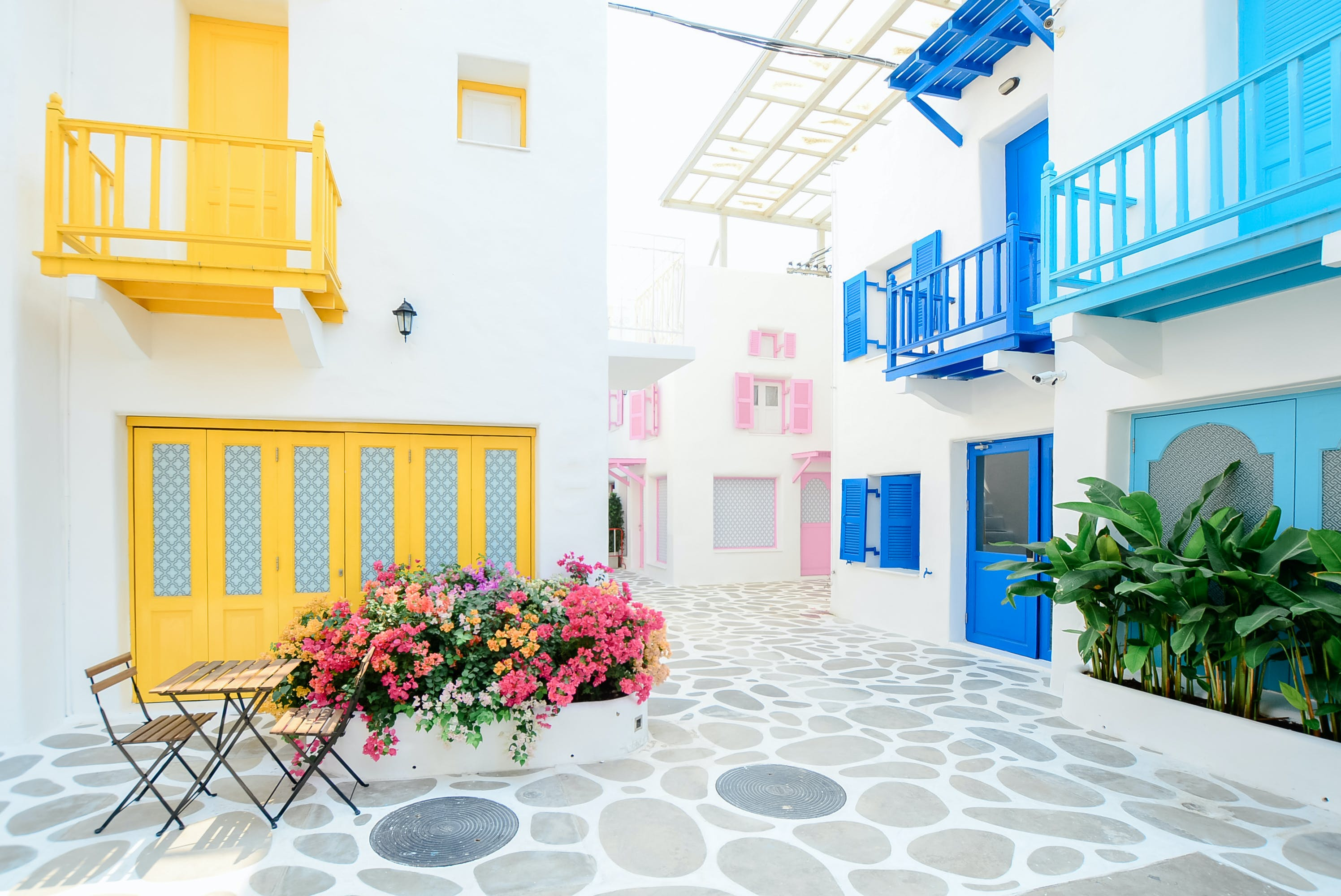 Architectural Photography of Three Pink, Blue, and Yellow Buildings