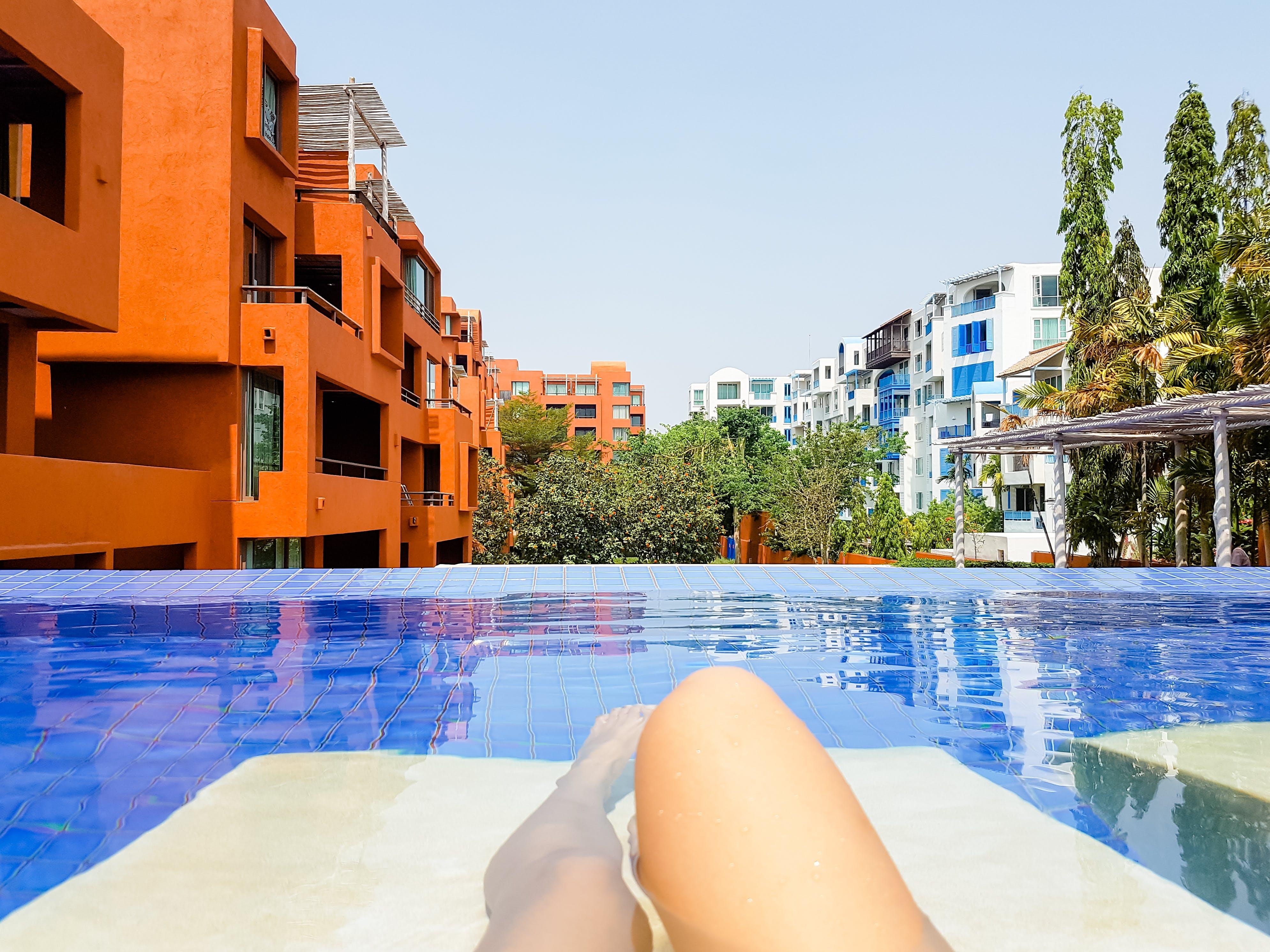 Swimming Pool Beside Orange Building