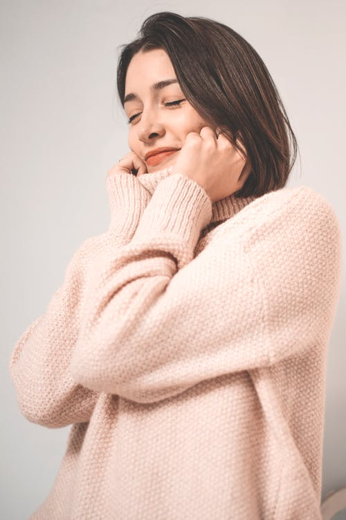 Woman Wearing Pink Knitted Sweater