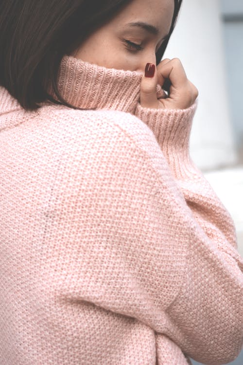 Photo of Woman Wearing Knitted Sweater