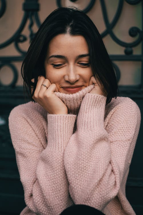 Woman Wearing Pink Sweater