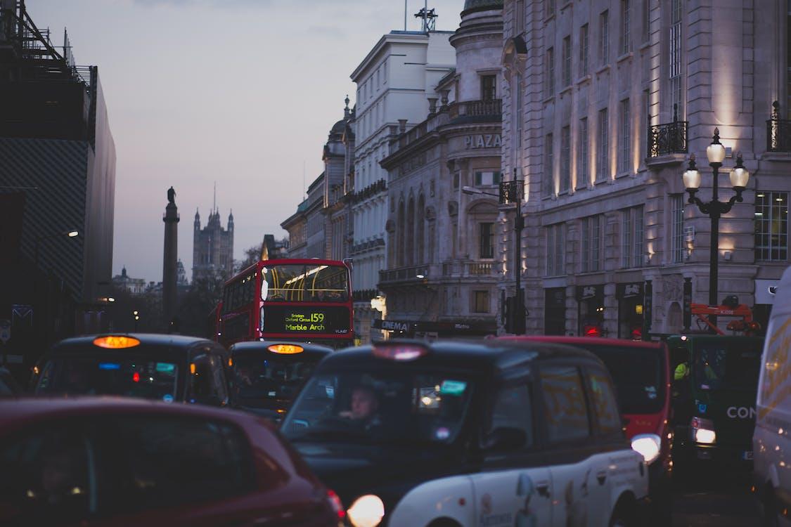 Car's on the Street Having Traffic during Twilight