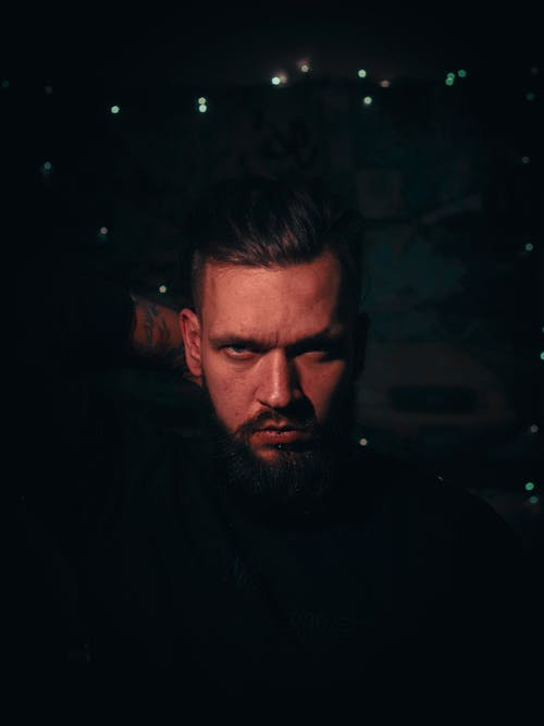 Free stock photo of beard, christmas lights, expression, face
