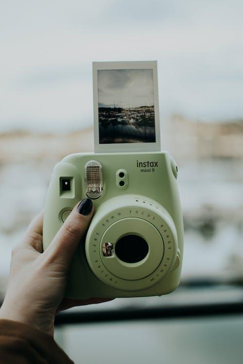 Photo Of Person Holding Polaroid