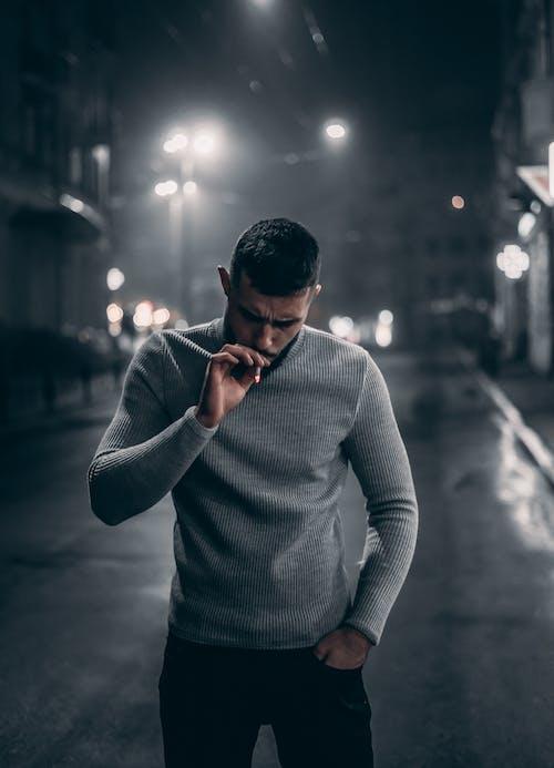 Photo Of Man Smoking Cigarettes