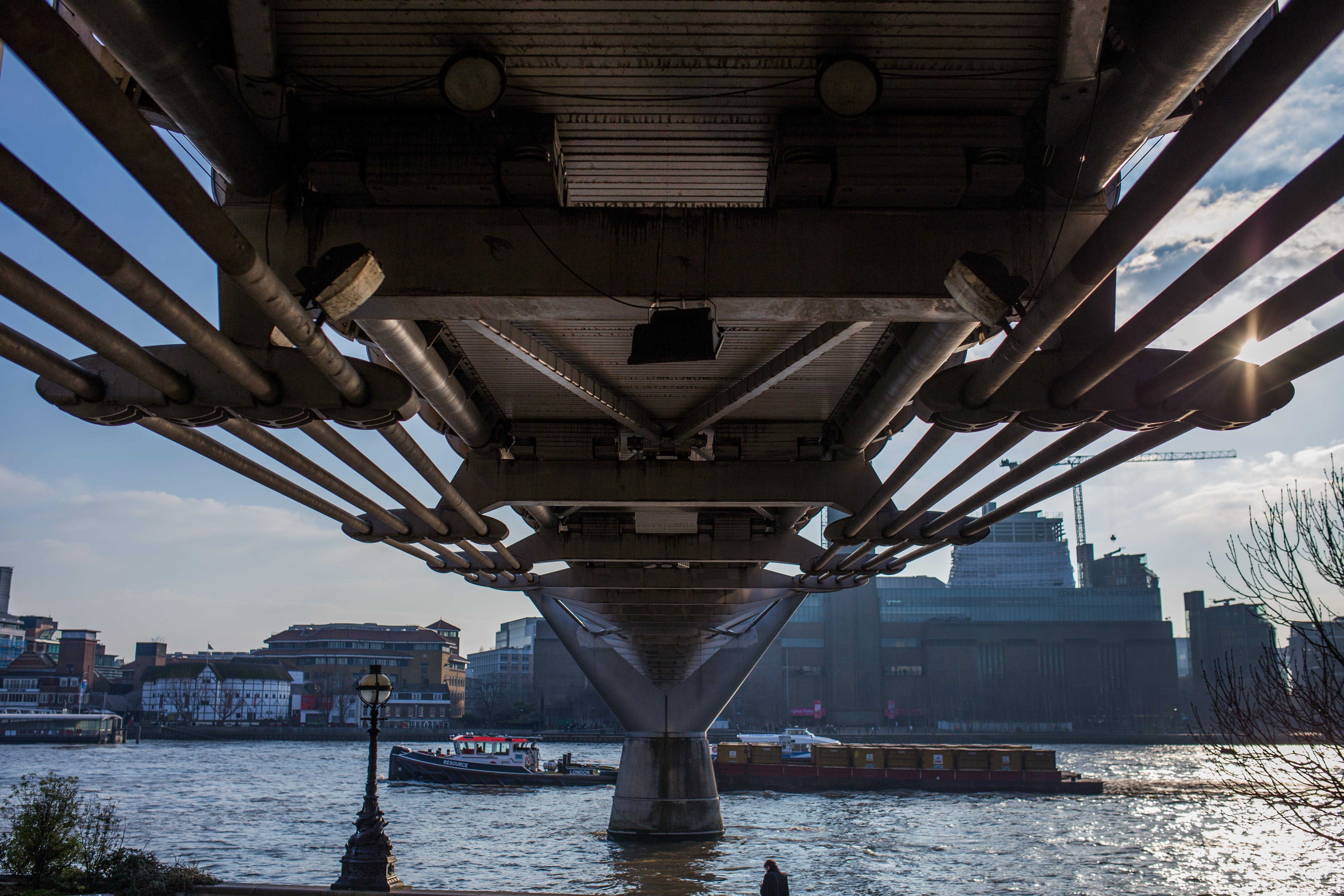 Body of Water over Gray Concrete Bridge