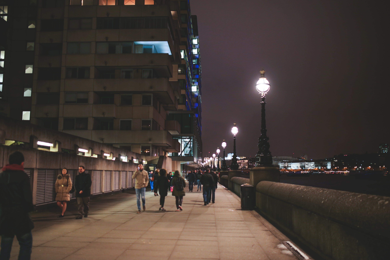 Free stock photo of light post, people walking, riverside, Riverside walk