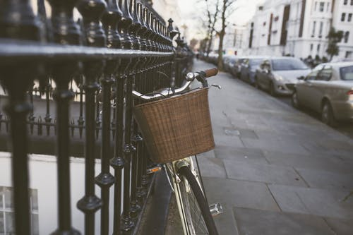 Silver Bicycle on Black Steel Fence