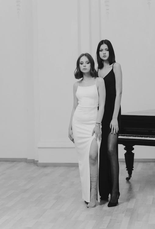 Women Wearing Black and White Dress