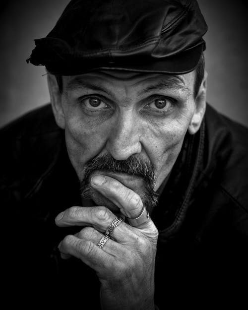 Grayscale of Photo of Men's Wearing Black Leather Hat