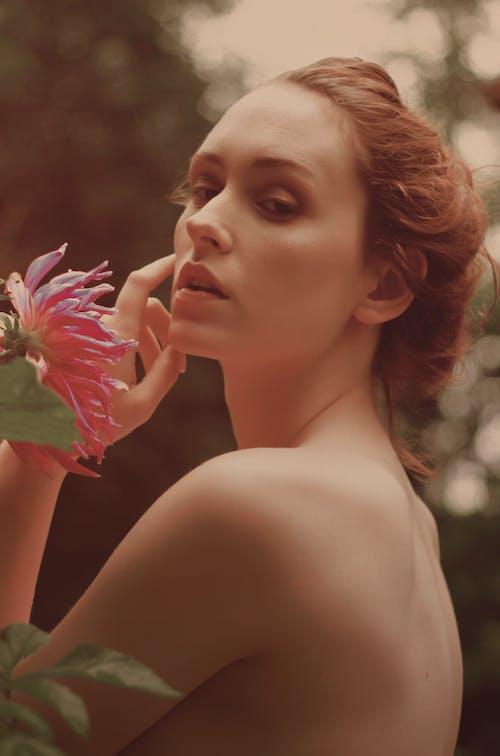 Woman Posing Near Pink Flower