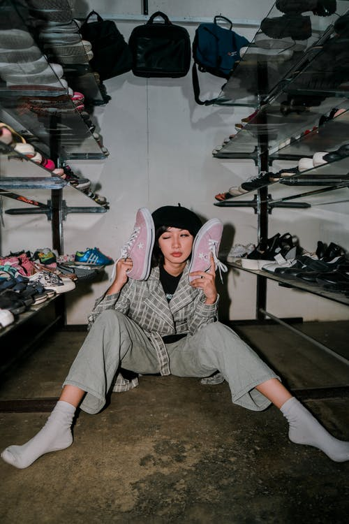 Eccentric woman with shoes in wardrobe