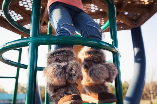 Person Wearing Brown Fur Mukluks Boots