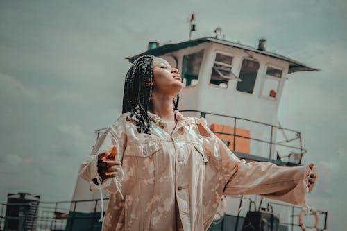 Woman Standing Near White Ship