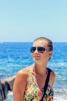 Free stock photo of sunglasses, vacation, woman, ocean