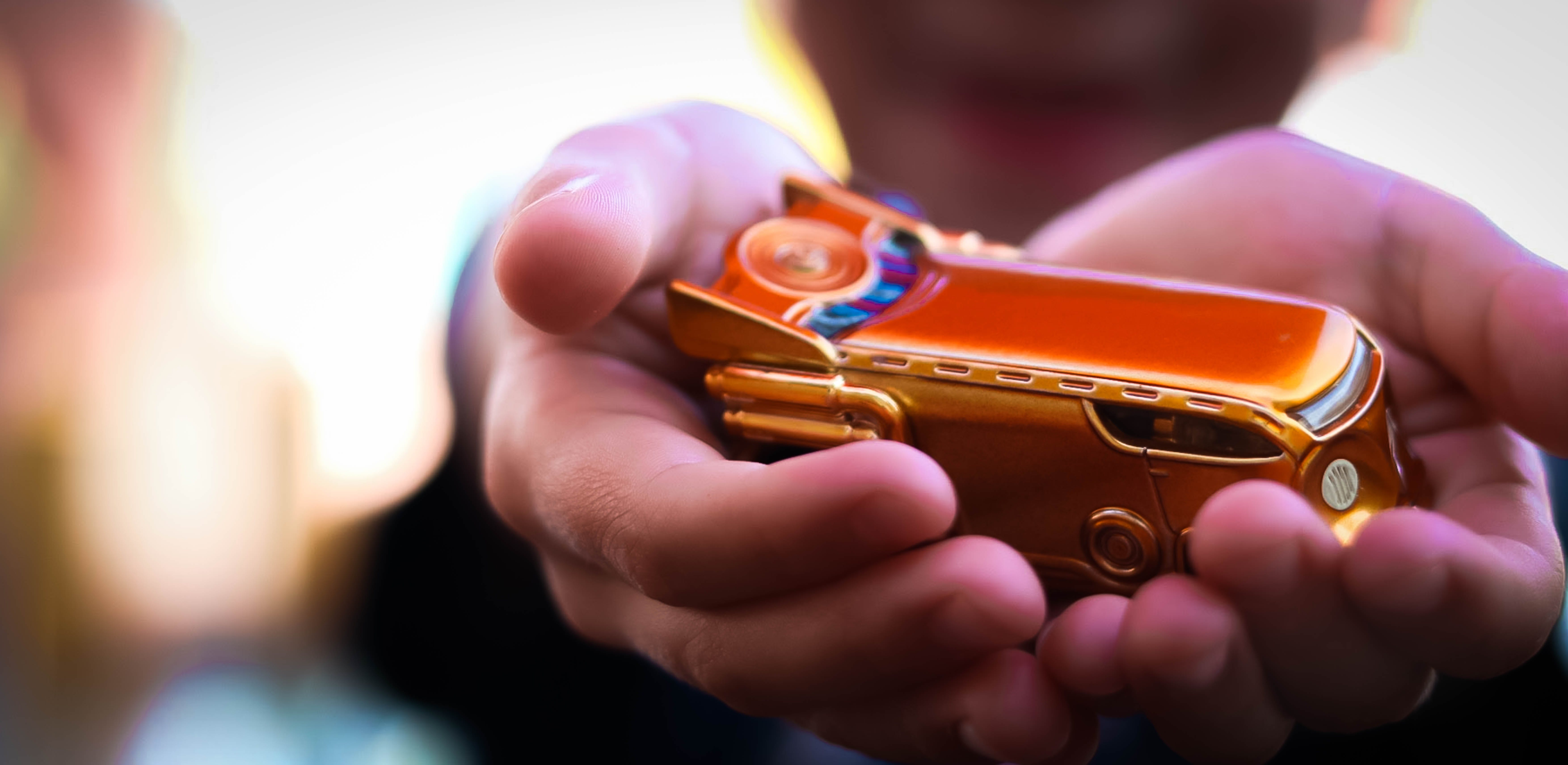 Person Holding Gold Car Toy
