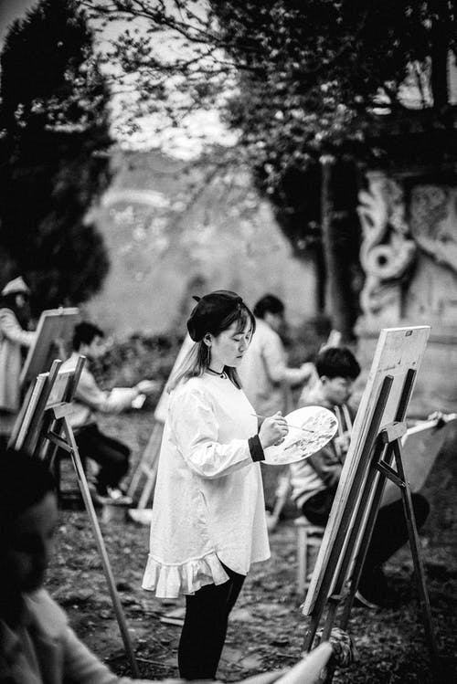 Grayscale Photography of Painters by Canvas