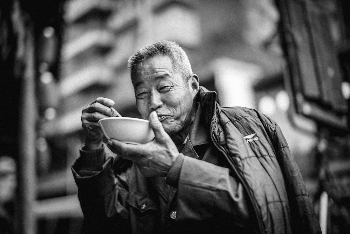 Old Man Eating on Bowl