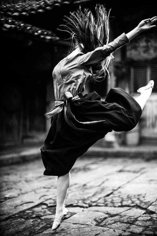 Woman in Black Skirt and White Long Sleeve Shirt Dancing Ballet