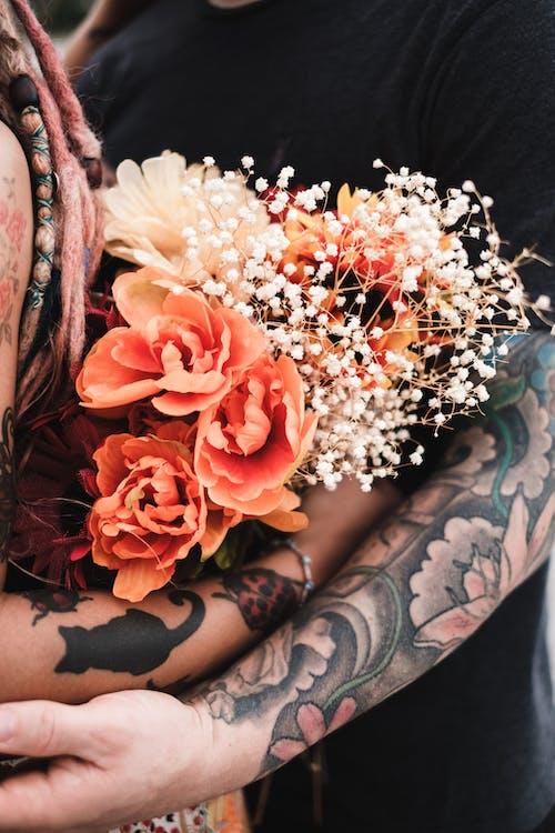 Free stock photo of beautiful flower, beautiful flowers, couple, couple hugging