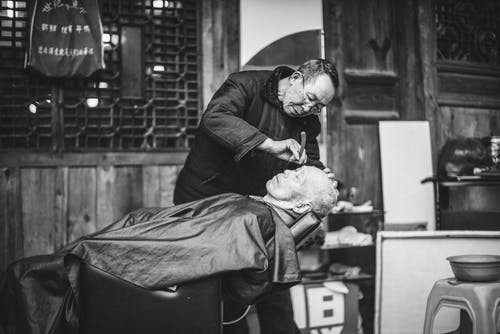 Grayscale Photography of Man Having A Haircut