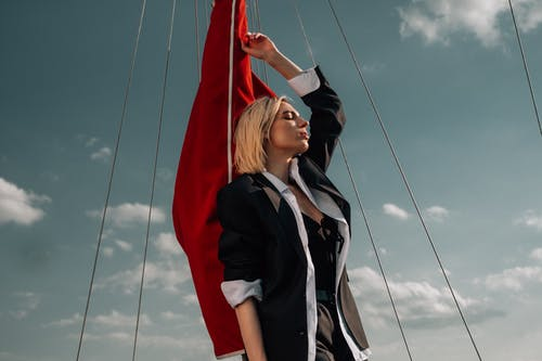 Woman Holding a Red Flag