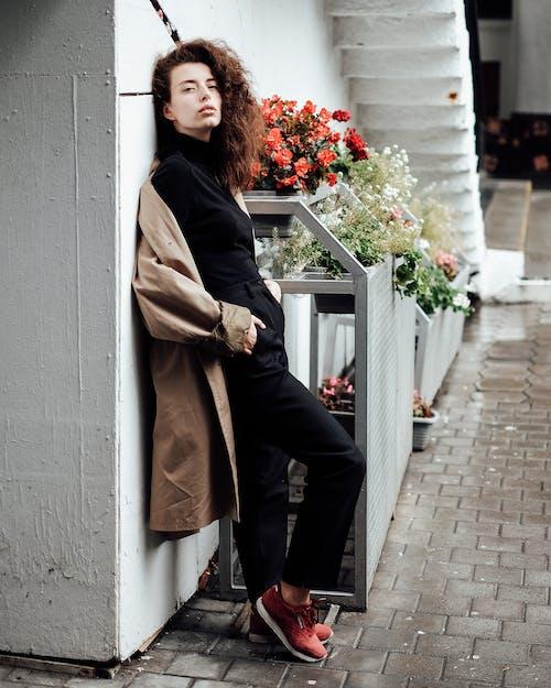 Woman in Brown Coat and Black Pants