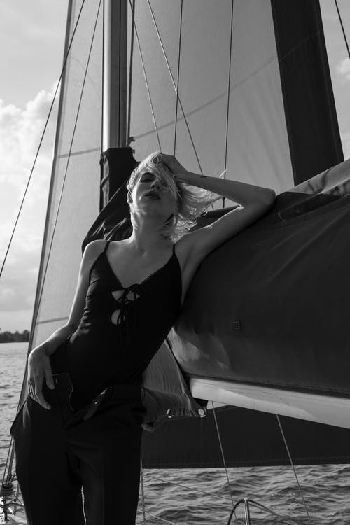 Grayscale Photography of Woman in Spaghetti Strap Top