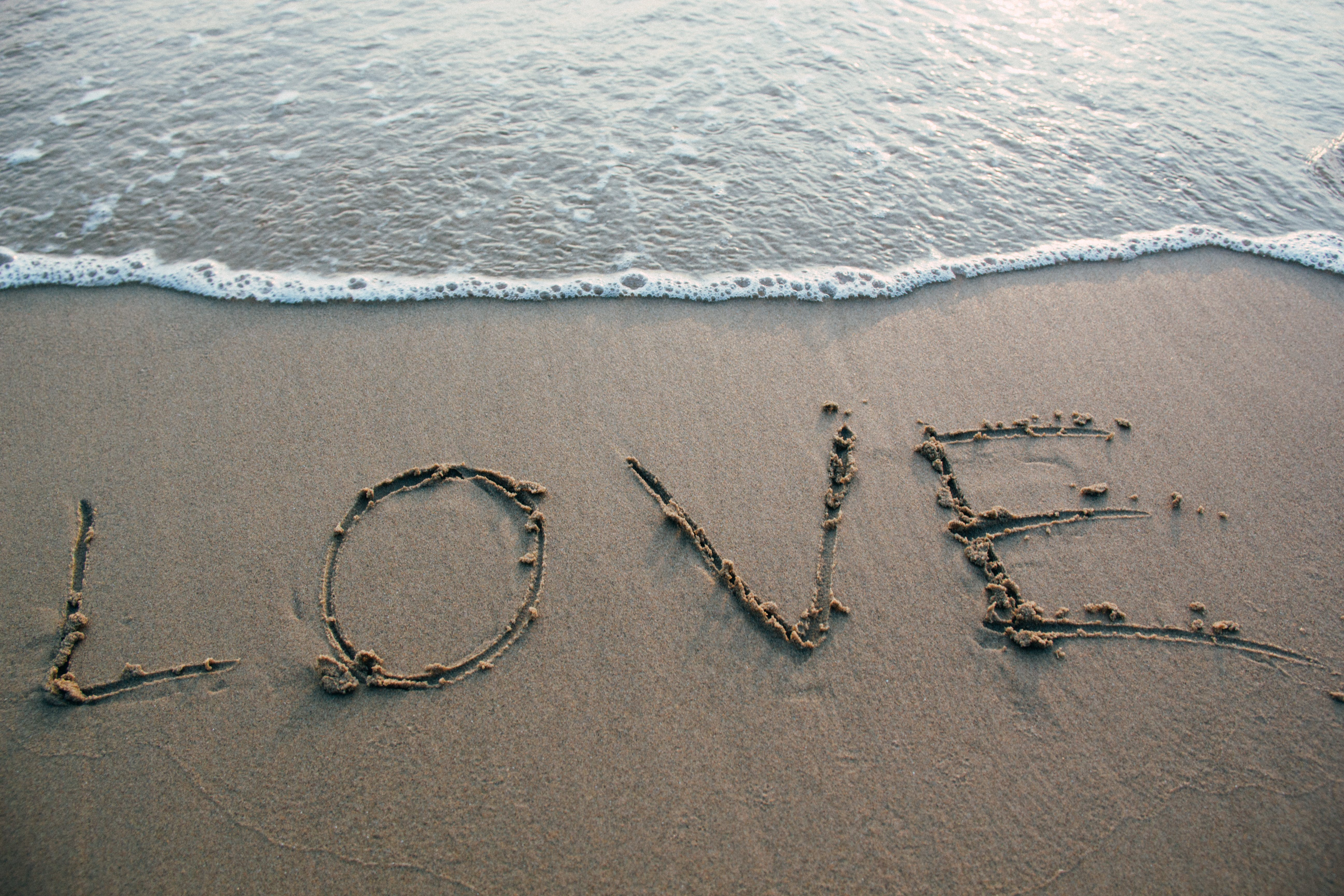 Brown Sand Love Text on Seashore