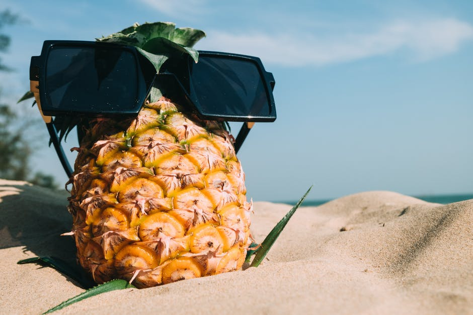 Pineapple Fruit With Sunglasses on Sand
