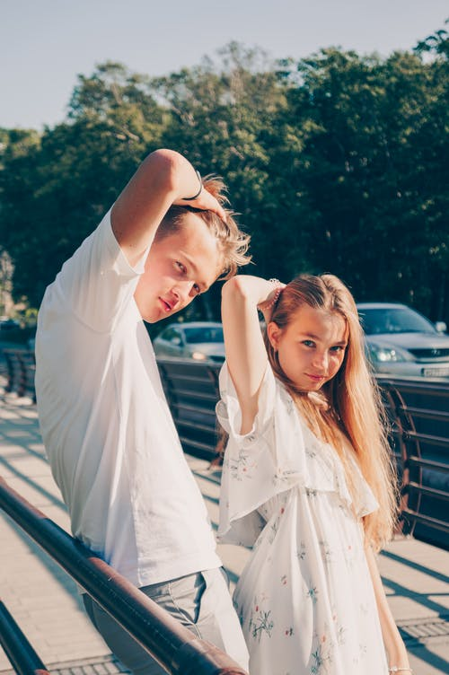 Girl and Boy Posing Near Street