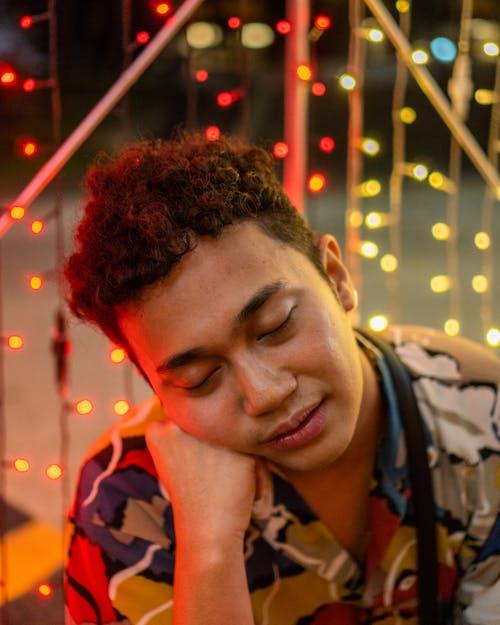 Portrait Photo of Man Closing His Eyes