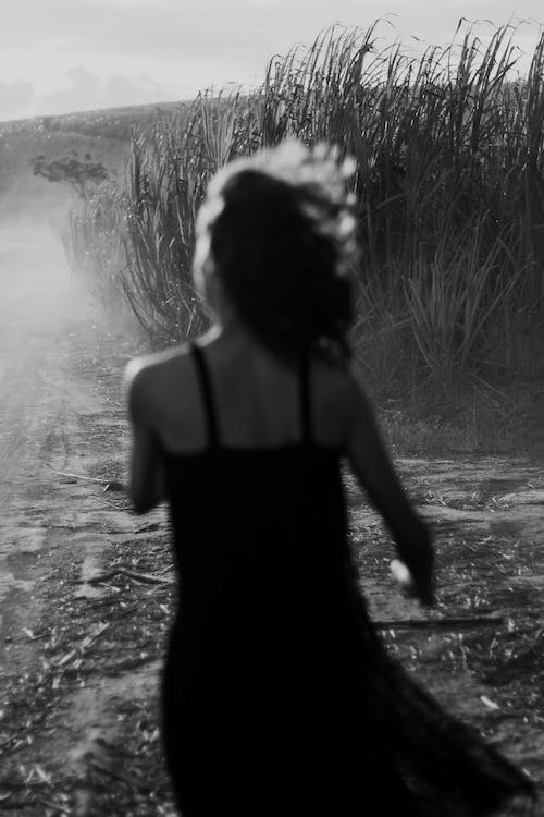 Grayscale Photography of Woman in Sleeveless Dress