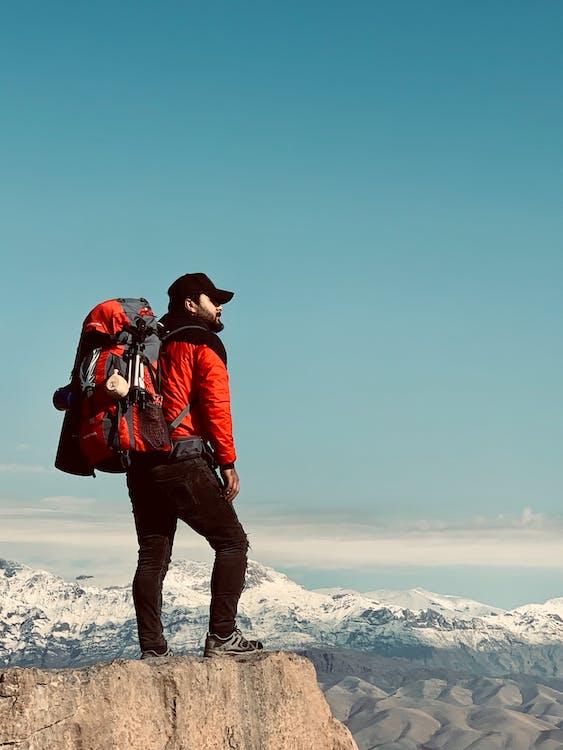 Man Standing on Cliff Edge